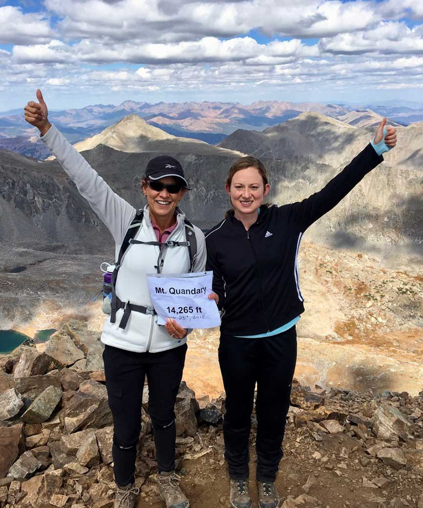 Showing leadership in coaching - Penny and daughter at the top of Mt. Quandary